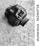 Small photo of Damage dirty vehicle alternator parts on garage concrete floor with Black Noir effect tone effect.