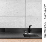 Stock photo modern kitchen with grey wall tiles black worktop sink and tap 562466299