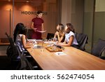 female boss and colleagues at... | Shutterstock . vector #562474054