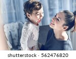 mother and her little daughter... | Shutterstock . vector #562476820