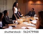 black businesswoman stands... | Shutterstock . vector #562479988