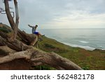 young man sitting on the tree... | Shutterstock . vector #562482178