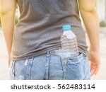 Water Bottle In A Female Back...