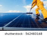 technicians are cleaning solar... | Shutterstock . vector #562483168