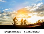 men ride a bicycle at sun set ... | Shutterstock . vector #562505050