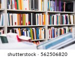 shelves with different books in ... | Shutterstock . vector #562506820