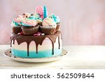 pink and blue festive cake with ... | Shutterstock . vector #562509844