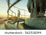 alone astronaut on alien planet.... | Shutterstock . vector #562518394
