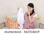 woman pinches her nose | Shutterstock . vector #562518619