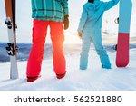 couple of skier and snowboarder ... | Shutterstock . vector #562521880
