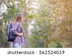woman tourist with backpack in... | Shutterstock . vector #562524019