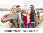 group of friends taking a... | Shutterstock . vector #562530514
