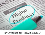 Stock photo digital producer advertisements and classifieds ads for vacancy in newspaper circled with a 562533310
