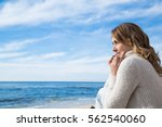 woman in winter at the seaside... | Shutterstock . vector #562540060