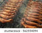 roasting barbecue bbq chicken... | Shutterstock . vector #562554094