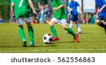 children soccer players running ...   Shutterstock . vector #562556863