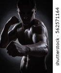 fighter silhouette. handsome... | Shutterstock . vector #562571164