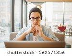 handsome businessman in casual... | Shutterstock . vector #562571356