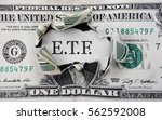 torn dollar with etf message ... | Shutterstock . vector #562592008