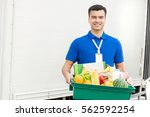 young man carrying food basket... | Shutterstock . vector #562592254