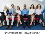 tired candidates wait for job... | Shutterstock . vector #562598464