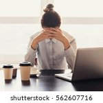 tired businesswoman in the... | Shutterstock . vector #562607716