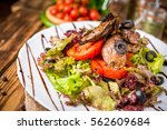 chicken liver salad with black... | Shutterstock . vector #562609684