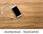 white smartphone on a wood... | Shutterstock . vector #562616443