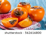 Persimmon Fruit On Rustic Tabl...