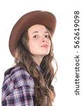 attractive girl in a cowboy hat | Shutterstock . vector #562619098