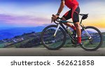 man on a bicycle on a road... | Shutterstock . vector #562621858