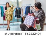 man waiting for his wife during ... | Shutterstock . vector #562622404