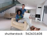 young multiethnic couple... | Shutterstock . vector #562631608
