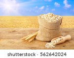 ears of oats and oatmeal in bag ... | Shutterstock . vector #562642024