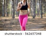 young woman running on the...   Shutterstock . vector #562657348