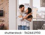 beautiful young couple hugging... | Shutterstock . vector #562661950