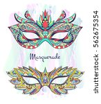 patterned mask on the grunge... | Shutterstock .eps vector #562675354