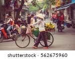vietnamese street  vendor | Shutterstock . vector #562675960