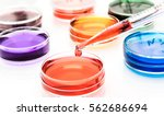 pipette with drop of color... | Shutterstock . vector #562686694