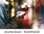 girl pointing finger on screen... | Shutterstock . vector #562696630