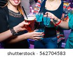 happy girls at a club party.... | Shutterstock . vector #562704583