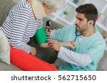 home care nurse using digital... | Shutterstock . vector #562715650