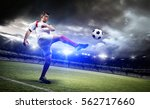 football player in the stadium | Shutterstock . vector #562717660