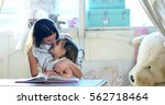 at home  in the bedroom  mom... | Shutterstock . vector #562718464