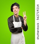 confident young chef with a... | Shutterstock . vector #562719214
