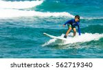 surfers waiting for a wave ... | Shutterstock . vector #562719340