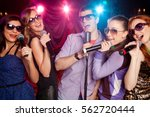 group of young people singing... | Shutterstock . vector #562720444