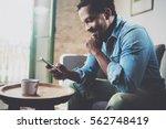 smiling bearded african man... | Shutterstock . vector #562748419
