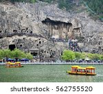 Small photo of The main Longmen Grotto from across the Yi River