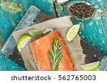 a piece of raw salmon  spices ... | Shutterstock . vector #562765003